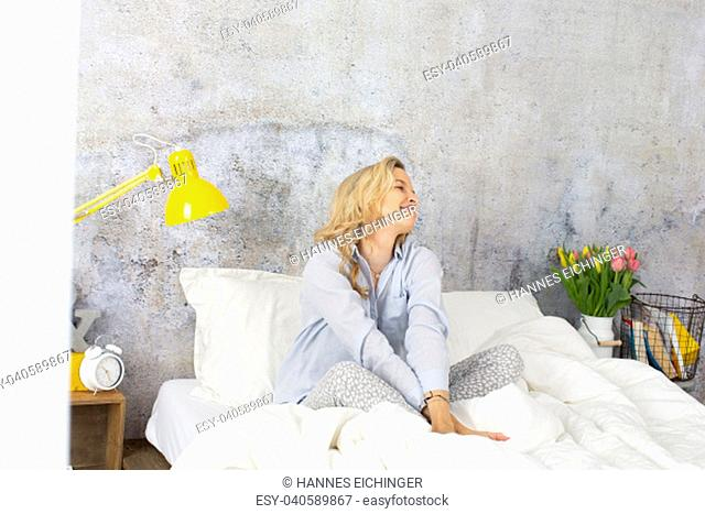 beautiful young woman in bed in the morning