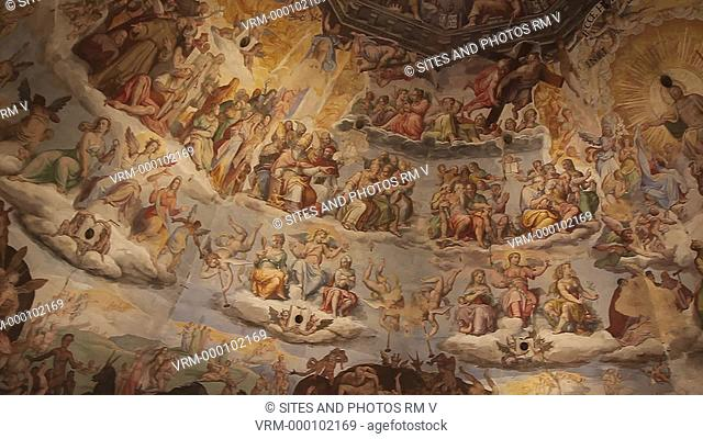 Interior, CU, PAN, view of the cathedral's dome fresco. Seen are scenes of the Last Judgment, begun by Vasari in 1568 and completed by Federico Zuccaro in 1579