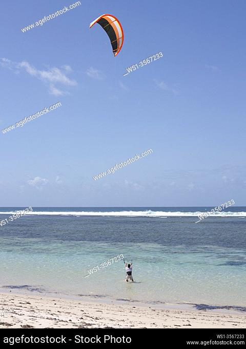 Tourists wind surfing on the beach at Tiwi, on Indian Ocean coast, Kenya