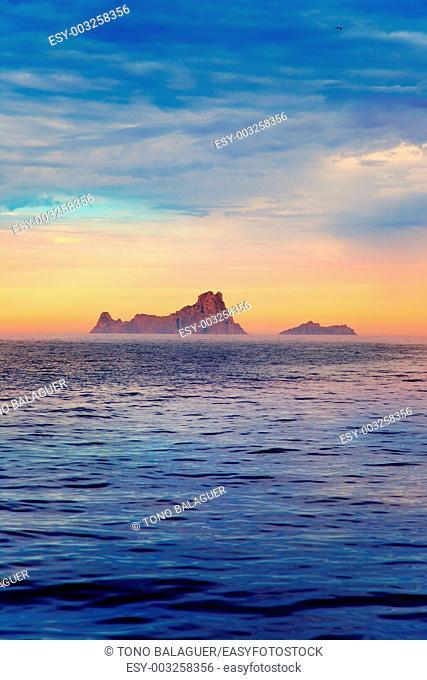 Ibiza sunset Es Vedra in Balearic islands view from Mediterranean sea