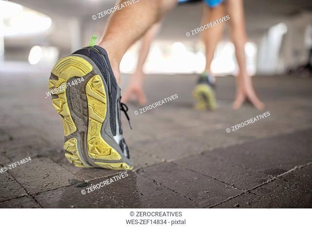 Shoe of sportive man stretching