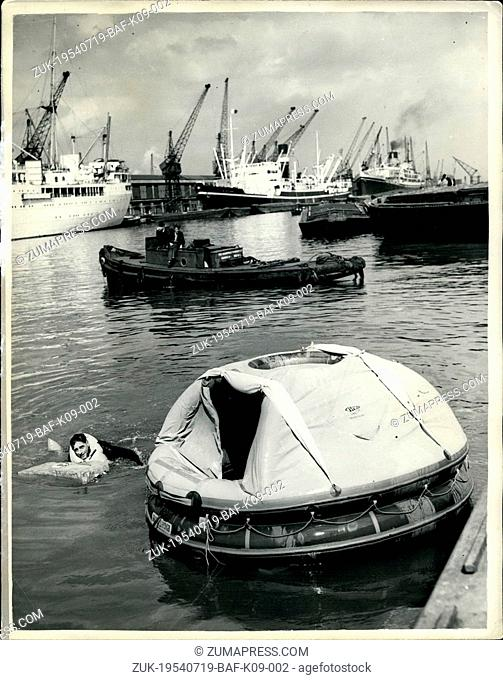 Jul. 19, 1954 - 19-7-54 Latest lifesaving equipment demonstrated. Frogman gets to work ?¢'Ǩ'Äú A demonstration was held in the King George V Dock, Southampton