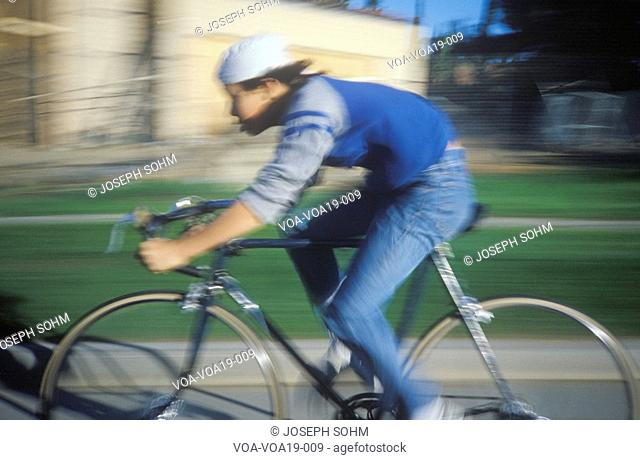 Young man riding bicycle in Marina Del Rey, CA