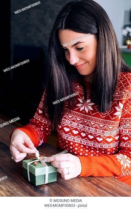 Woman decorating Christmas present