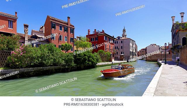 Taxi boat on small Channel Rio Nuovo, Venice, Italy, Europe / Taxiboot auf dem kleinen Kanal Rio Nuovo, Venedig, Italien, Europa