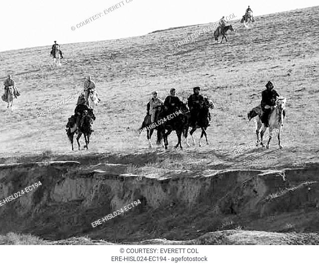 U.S. Army Special Forces ride horse-back alongside Afghan Northern Alliance horse cavalry. Special Forces were inserted in territory held by the anti-Taliban...