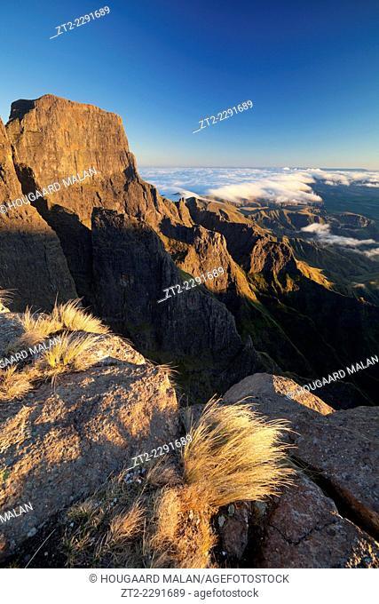 Landscape photo of warm morning light on the Sentinel. Royal Natal National Park, Drakensberg, South Africa