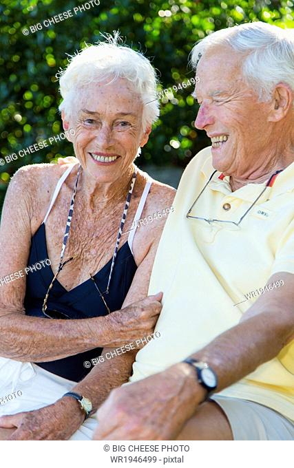 Portrait of a senior couple sitting outdoors