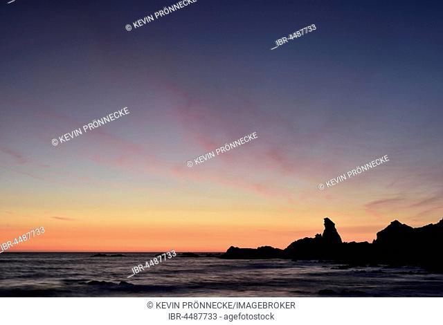 Rocky coast in the evening light, Sunset, Atlantic Coast, Hartland Quay, Devon, United Kingdom