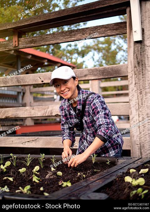 Australia, Melbourne, Portrait of smiling woman working in community garden