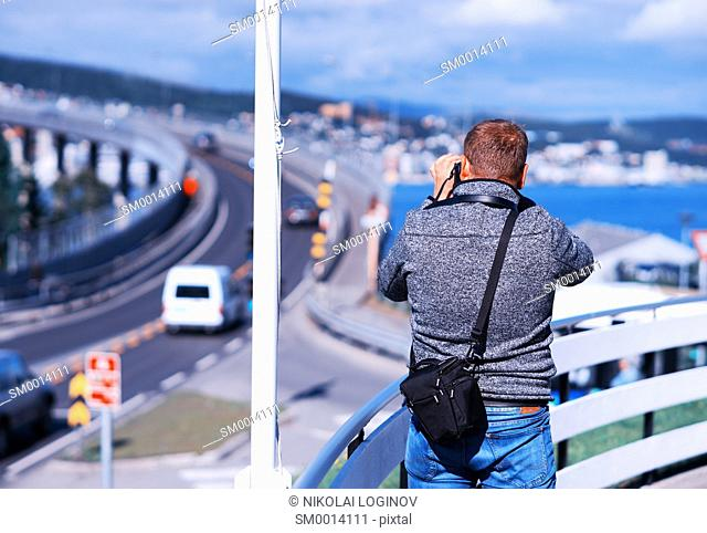 Photographer taking Norway pictures background hd