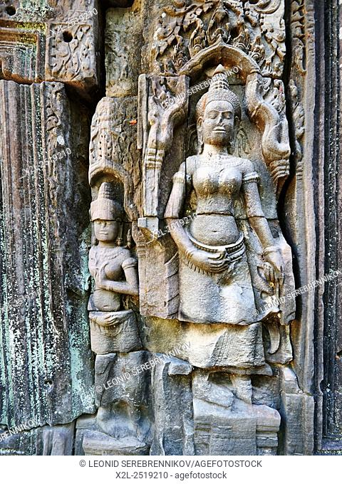 Stone carving on wall in Banteay Kdei temple. Angkor Archaeological Park, Siem Reap Province, Cambodia