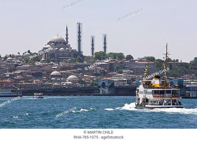 Ferry boat on Bosphorus with the Suleymaniye Mosque in the distance, Istanbul, Turkey, Europe