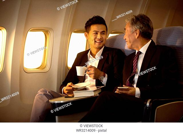 Business people by plane