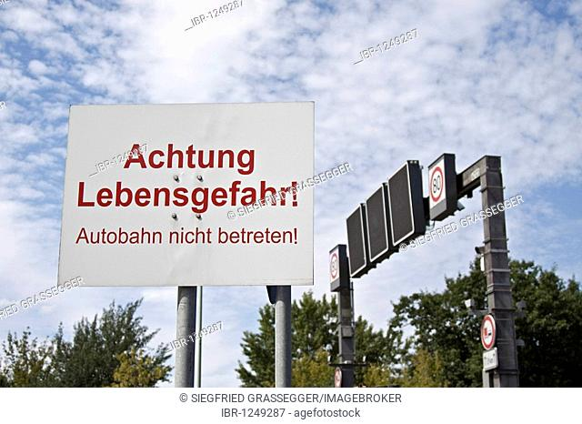 Warning sign on a highway Achtung Lebensgefahr! Autobahn nicht betreten! Attention, mortal danger! Do not enter the highway by foot!