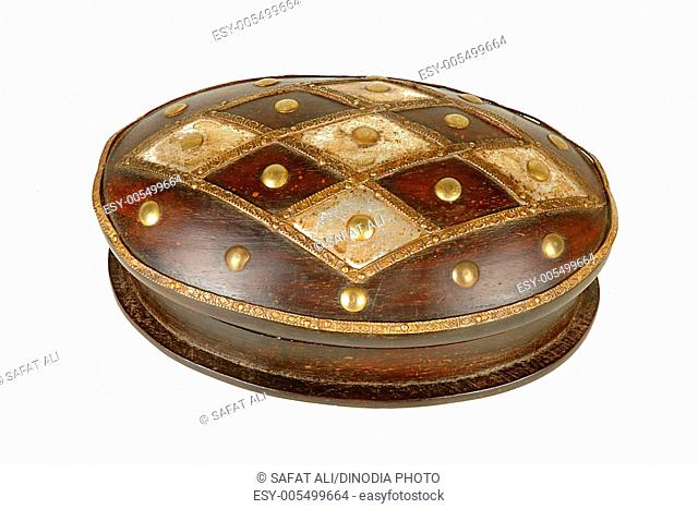 Brass design fitting on antique wooden round box ; Jodhpur ; Rajasthan ; India