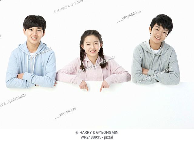 Portrait of three smiling teenagers in casual clothes