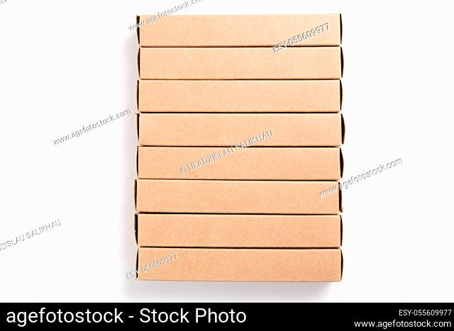 Oblong cardboard boxes on white background. Mockup image. Delivery and package concept