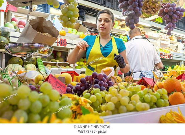 Saleslady at fruit stand, Cagliari, Sardinia, Italy
