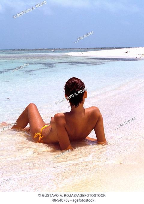 Woman on beach, Los Roques. Venezuela