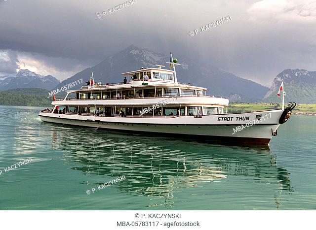 Excursion ship Stadt Thun on Lake Thun with an approaching thunderstorm, spring, Oberhofen, canton Berne, Switzerland, Alps