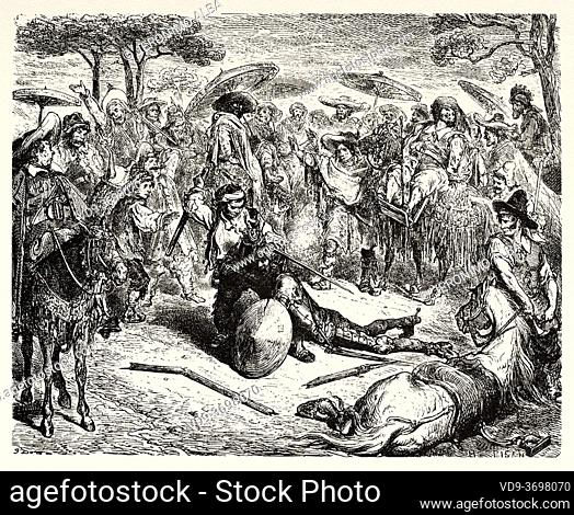 Don Quixote he thrashed him like a wheat-sheaf. Don Quixote by Miguel de Cervantes Saavedra. Old XIX century engraving illustration by Gustave Dore