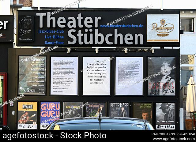 """17 March 2020, Hessen, Kassel: Between the concert event posters of the club """"""""Theaterstübchen"""""""" hangs the information about the closing due to the coronavirus"""