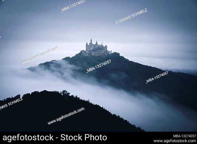 Hohenzollern Castle in the fog at sunset, Germany