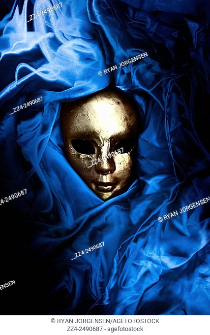 Linen shroud of blue irtyu symbolised as the ancient Egypt color of the heavens and the dominion of the gods covers a mummified Pharaoh wearing a ritual gold...