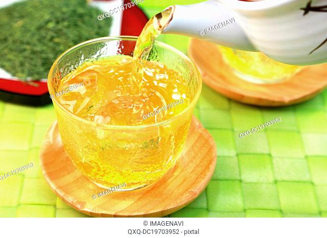 Japanese iced tea being poured into a cup