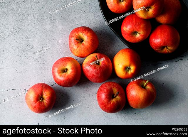Red apples on stone background