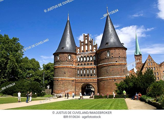 Holstentor Gate in front of the steeple of the St. Petri church in the Hanseatic city of Luebeck, UNESCO World Cultural Heritage Site, Schleswig-Holstein