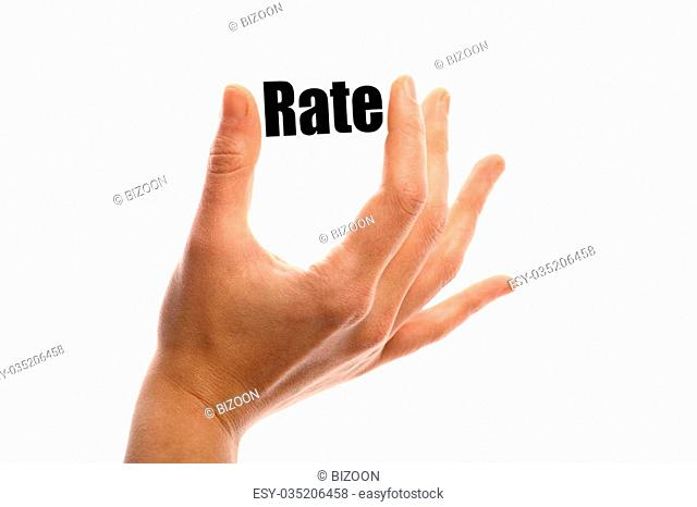 """Horizontal shot of a hand holding the word """"""""Rate"""""""" between two fingers, isolated on white"""