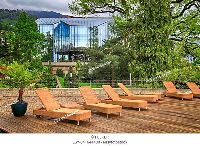 outdoor terrace with deck chairs in hotel, Montreux, Switzerland. Montreux is located on Lake Geneva at the foot of the Swiss Alps