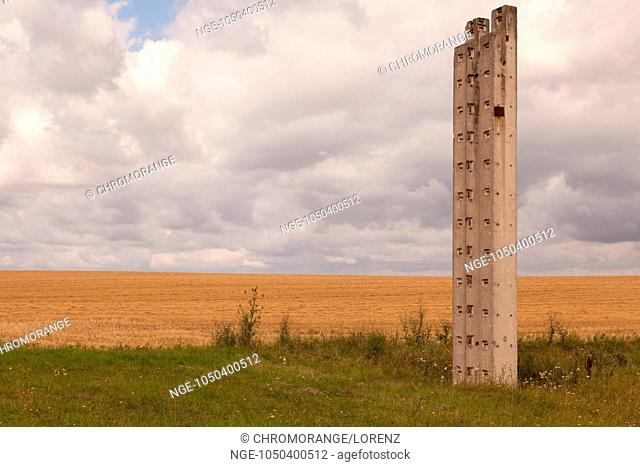 Pillars out of cement are standing in the countryside