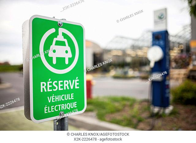 French reserved for electric cars sign in parking lot