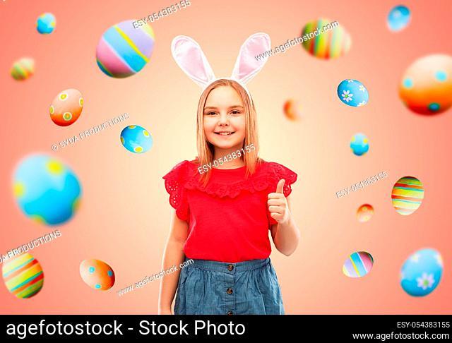 girl wearing easter bunny ears showing thumbs up