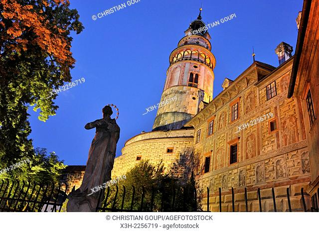 statue of saint beside the tower of the Cesky Krumlov Castle at dusk, South Bohemia, Czech Republic, Europe