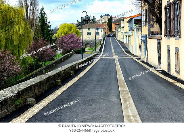 empty street along Allier river leading to Chateau, Pont-du-Château, Puy-de-Dôme department, Auvergne, central France near strategic crossroad of motorways...