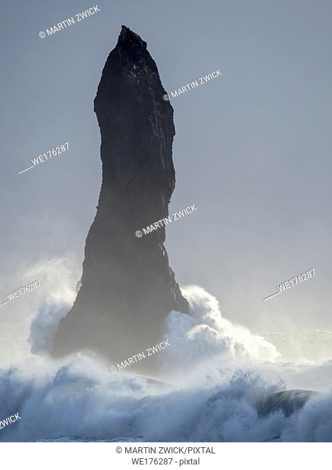 The coast of the north atlantic near Vik y Myrdal during winter. The sea stacks Reynisdrangar. Europe, Northern Europe, Scandinavia, Iceland, February