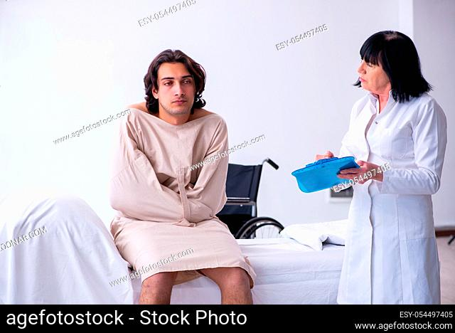 The old female psychiatrist visiting young male patient