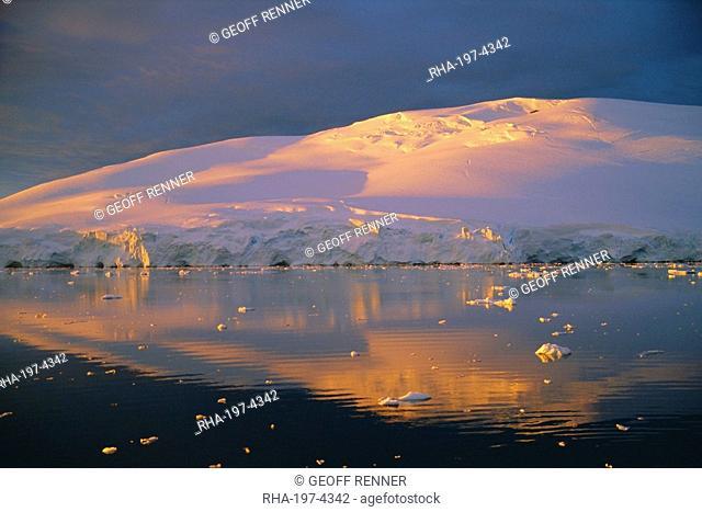 Coastal landscape lit by the midnight sun, Antarctic Peninsula, Antarctica