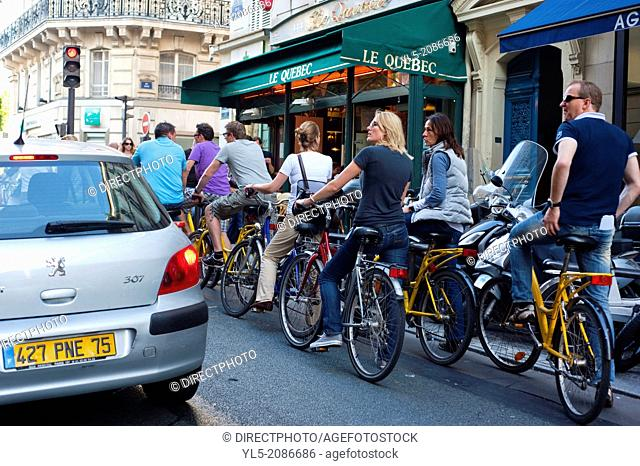 Paris, France, Group YOung Tourists Visiting Paris on Bicycles Tour in Latin Quarter, Saint Germain des prés, Street