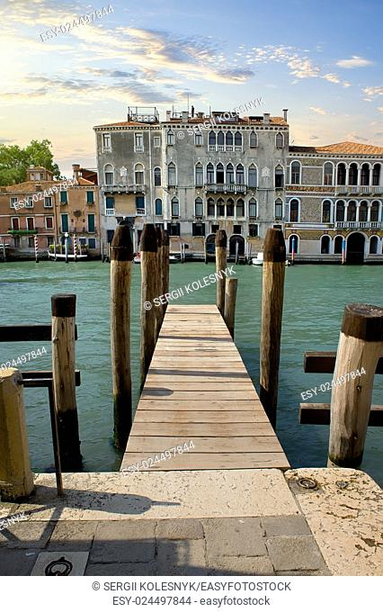 Small wooden jetty on Grand Canal in Venice