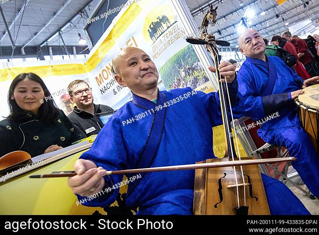 11 January 2020, Baden-Wuerttemberg, Stuttgart: Traditional musicians from Mongolia play on instruments at the stand of a tour operator at the travel fair CMT