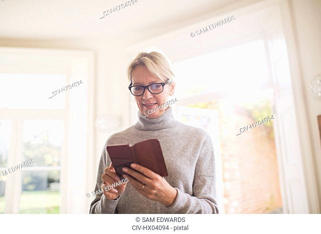 Mature woman reading diary