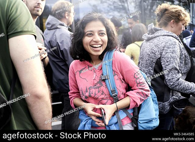 Young indian woman enjoying trip to nature. Eibsee, Bavaria, Germany
