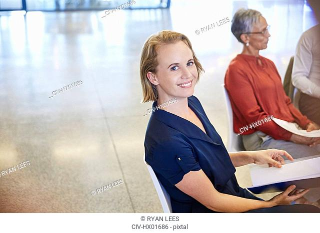 Portrait smiling businesswoman in meeting