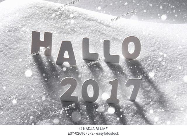 White Letters Building German Text Hallo 2017 Means Hello 2017 In Snow. Snowy Scenery With Snowflakes For Happy New Year Greetings
