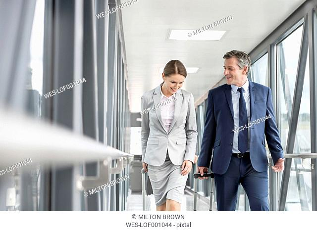 Businessman and businesswoman on jet bridge at the airport